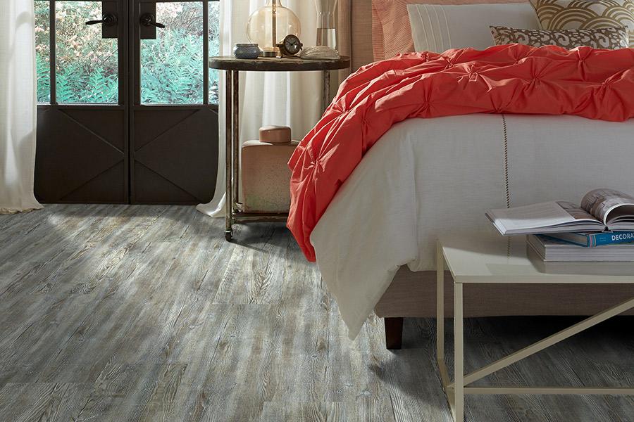 Luxury vinyl flooring in a Lubbock, TX master bedroom