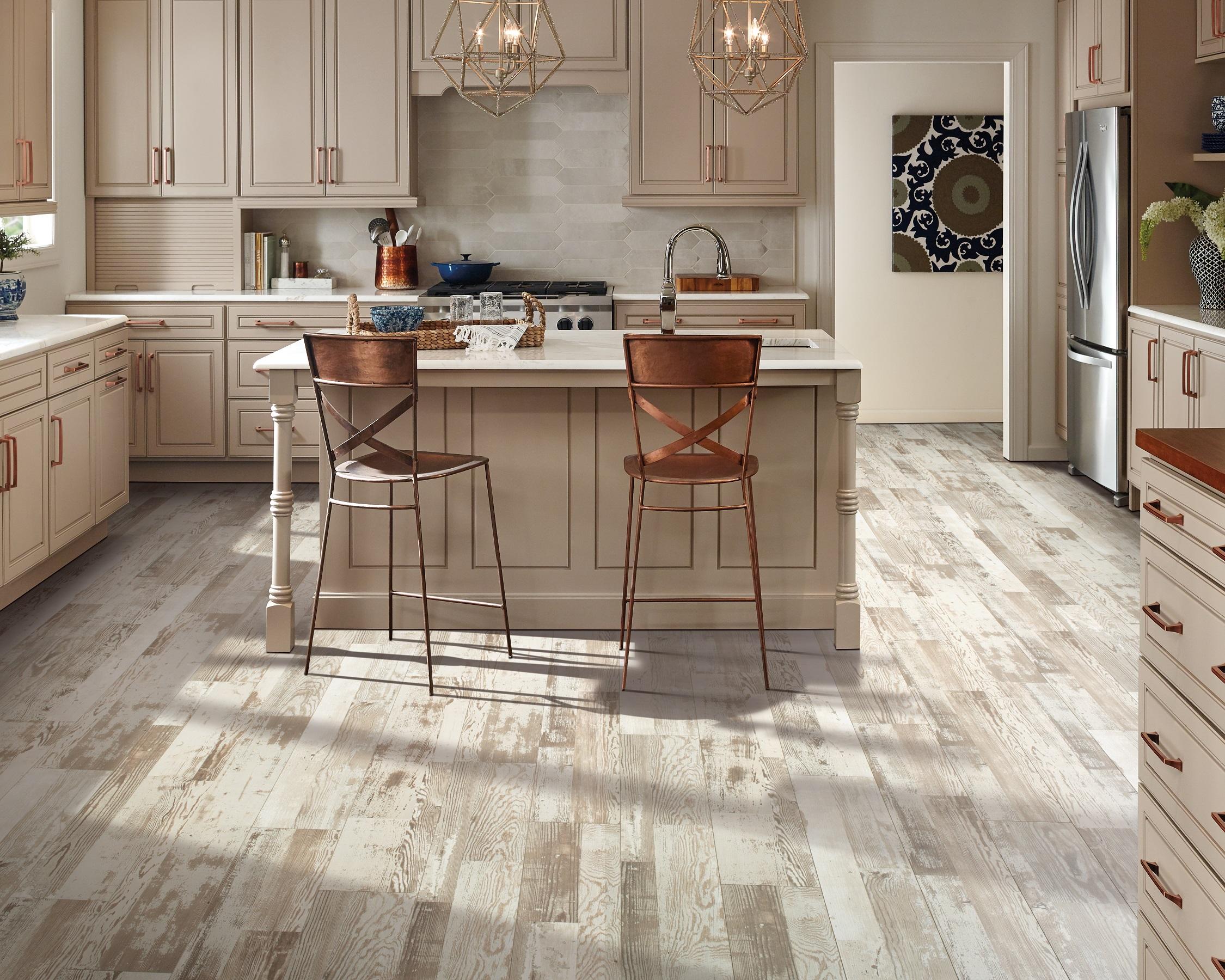 Light/blonde wood-look laminate flooring in a Georgetown, KY home