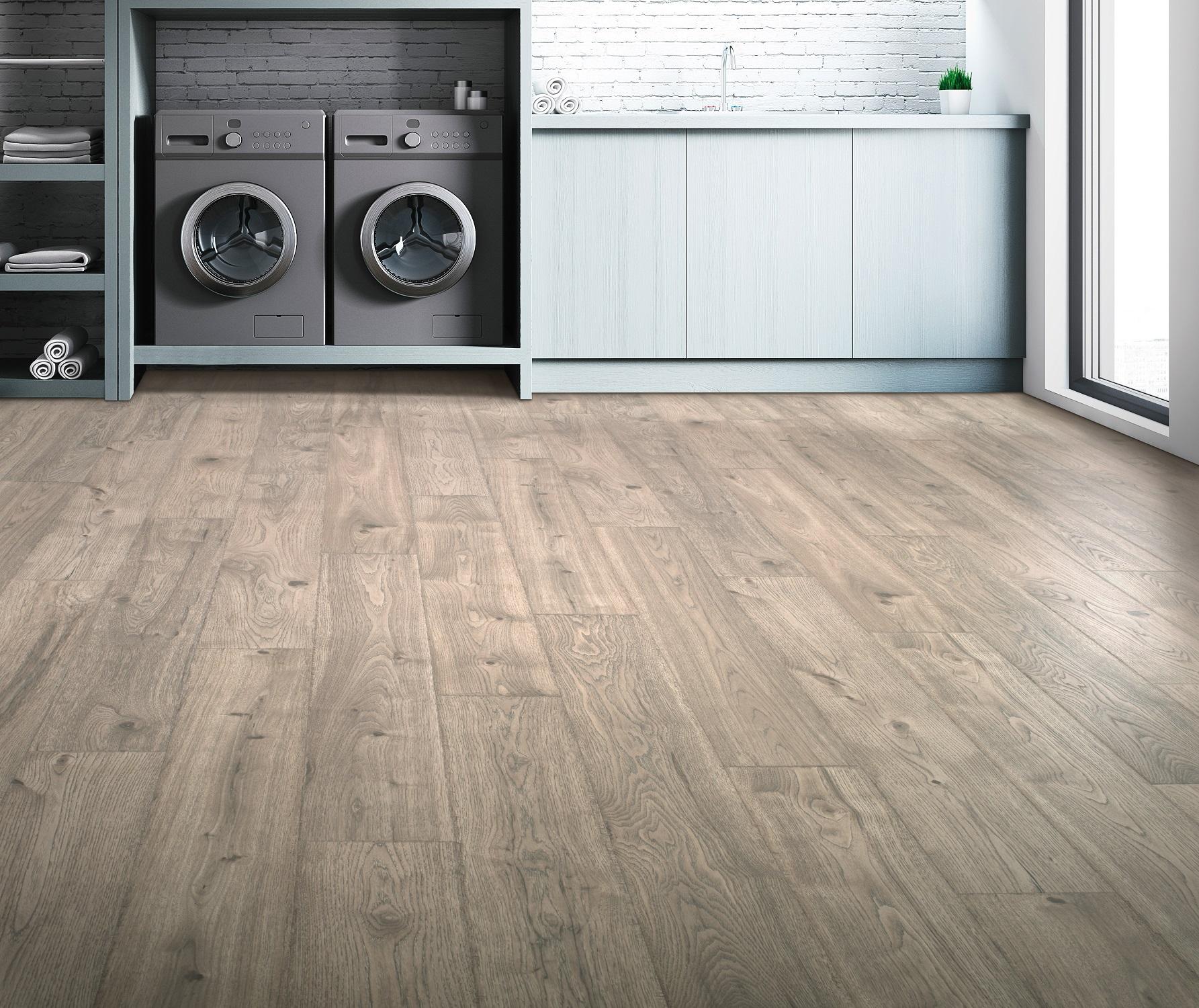 Waterproof laminate flooring in a Winnipeg, MB laundry room