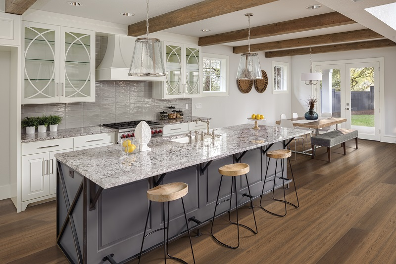 An Image Of A Kitchen With LVP Flooring.