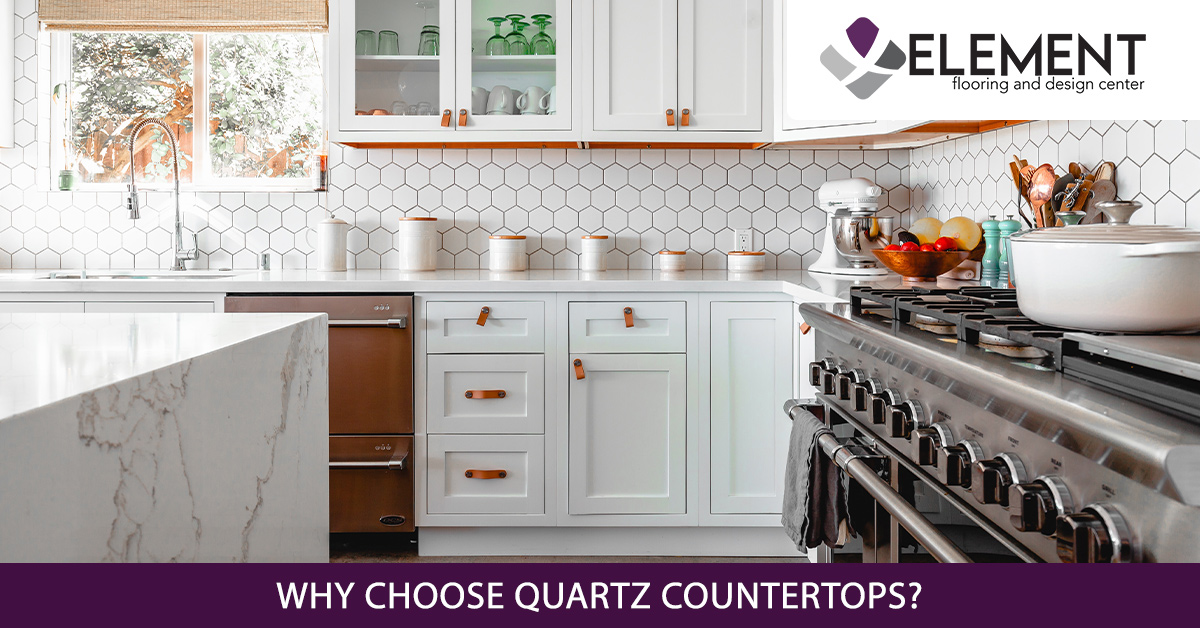 An image of a kitchen with white quartz countertops.