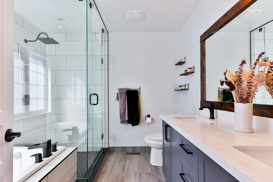 A picture of bathroom with LVP or vinyl flooring.