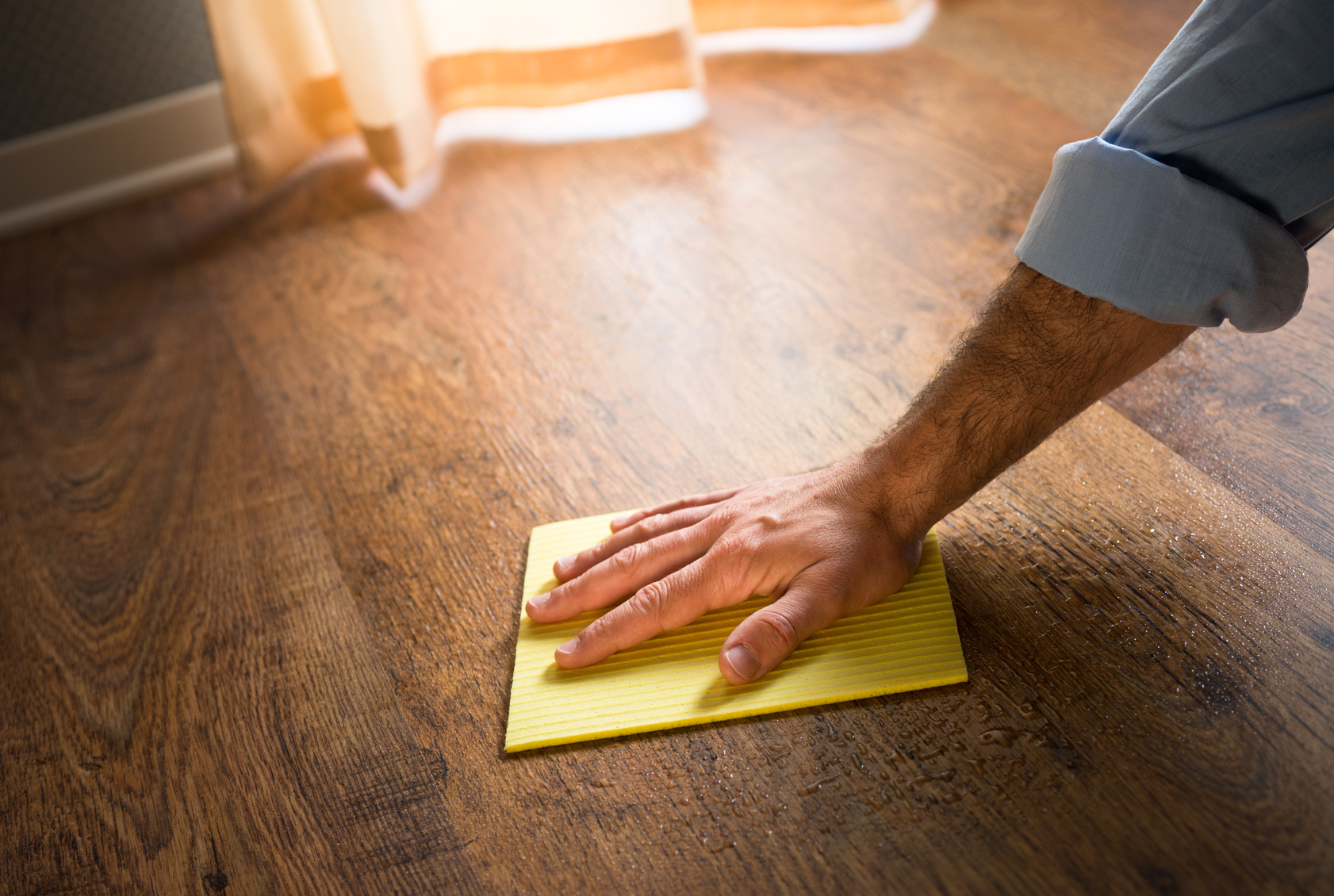 Cleaning wood floors in a Fort Myers, FL home