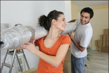 Professionals installing carpet flooring