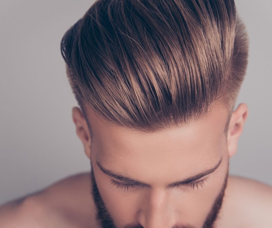 White male with pompadour haircut, shorter on sides and longer on top