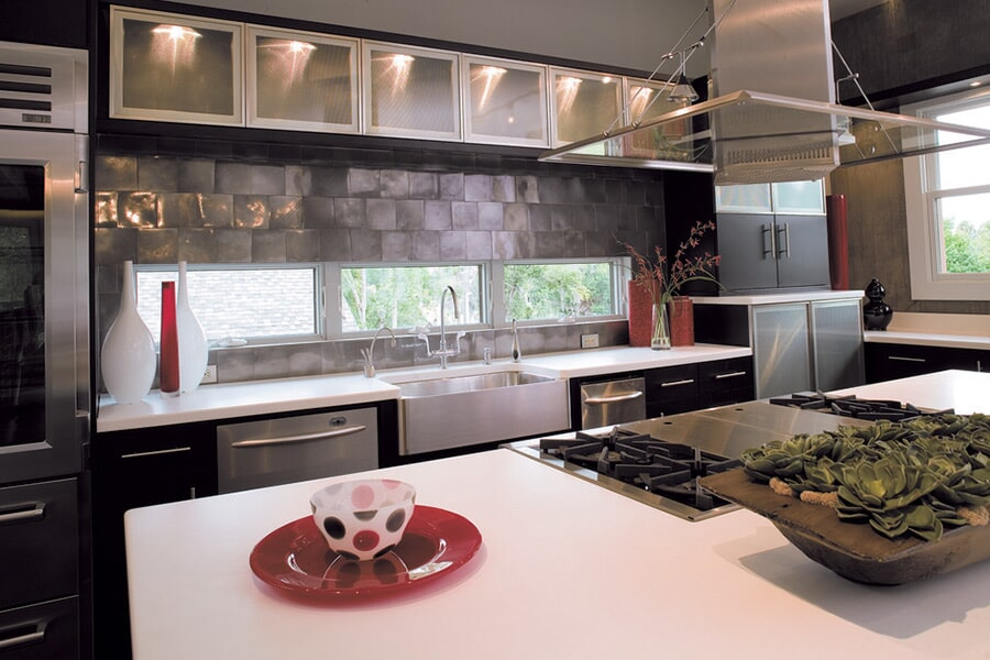 Modern kitchen with metal tile accents in