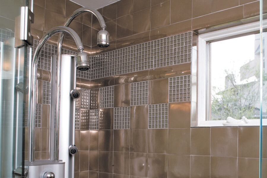Custom metal tile shower in