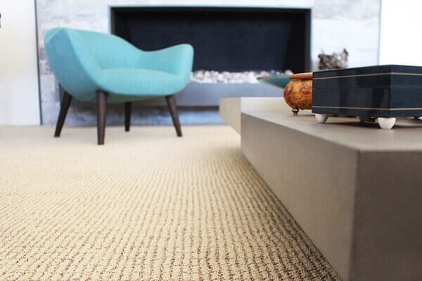 Sand colored berber carpet in a mid century modern makeover near Poway CA by Metro Flooring