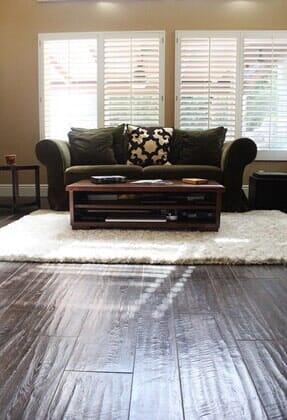 Dark wood floors with soft area rug near Rancho Penasquitos CA by Metro Flooring