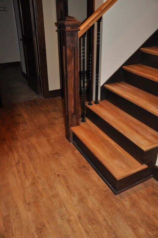 Stained Oak Stairs with Iron Balusters