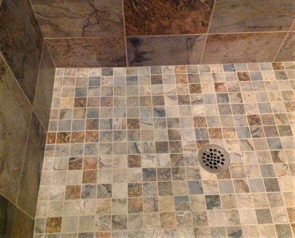 Bathroom shower tile floor installation in Billings, MT by Covering Broadway
