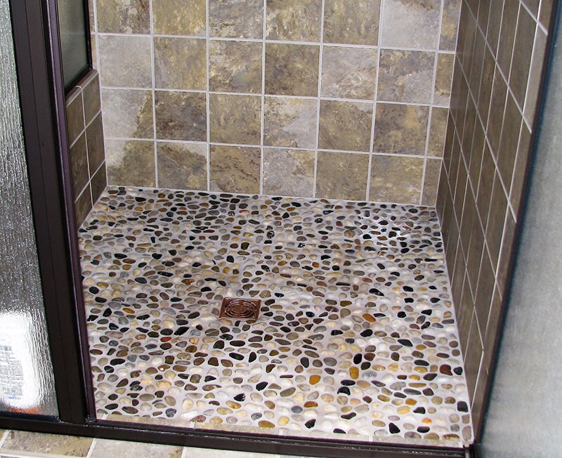 Natural stone shower floor installation in Roberts,  MT by Covering Broadway