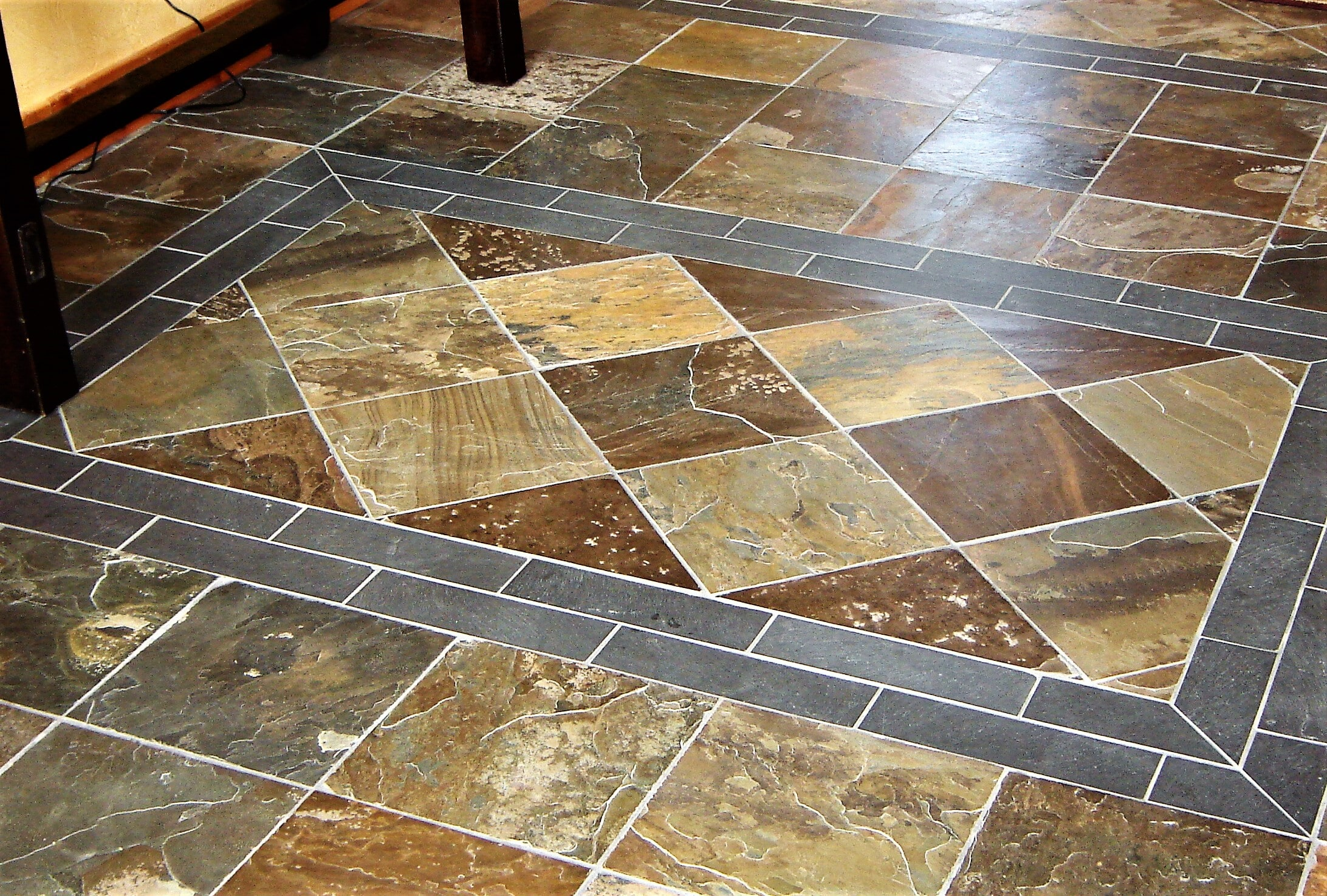 Natural stone floor installation in Belfry, MT by Covering Broadway