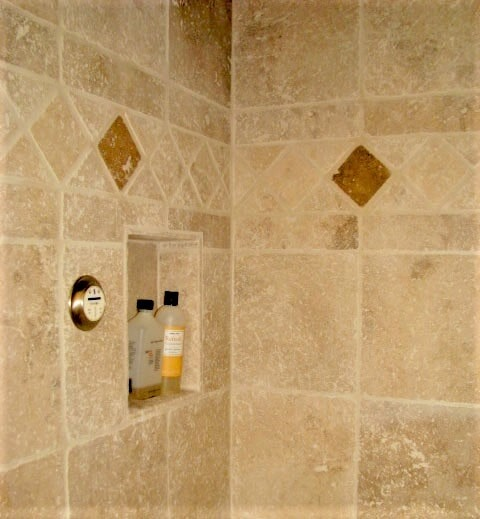 Natural stone bathroom tile installation in Red Lodge, MT by Covering Broadway