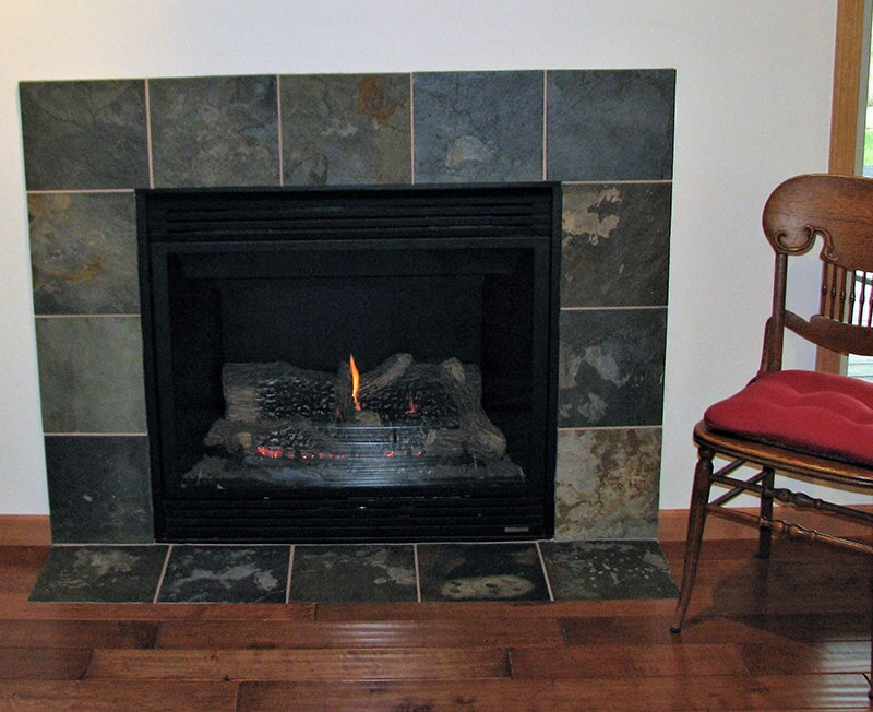 Natural stone fireplace surround in Bridger, MT from Covering Broadway