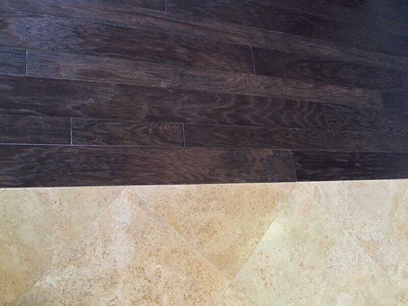 Tile and wood flooring together in Rochester NY by Christian Flooring
