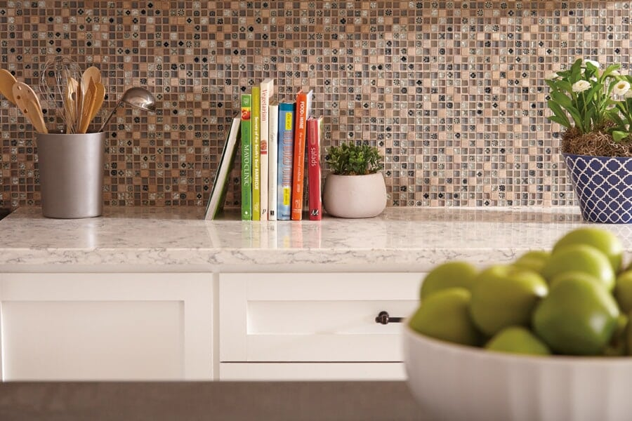Glass tile backsplash installation in