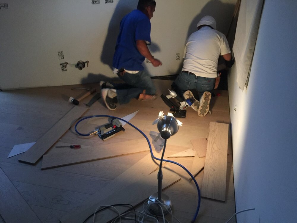 Dedicated professionals! Finishing the flooring installation in San Mateo, CA by Luxor Floors Inc.