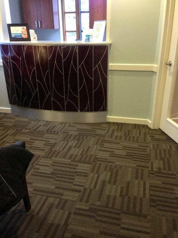 Mohawk carpet tile installation in reception of Dr. Vargas - Chappaqua Smiles.