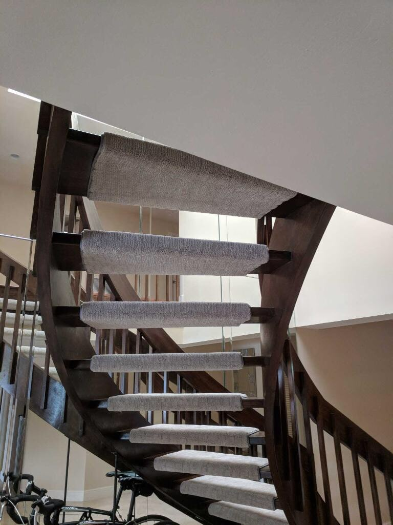 Stairway installation from Capitol Carpet & Tile and Window Fashions in Palm Beach Gardens, FL