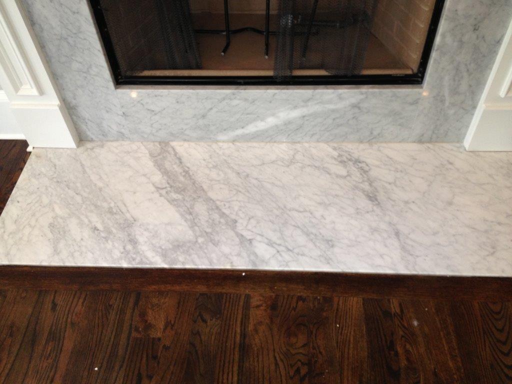 Custom granite fireplace in Braselton GA from Purdy Flooring & Design