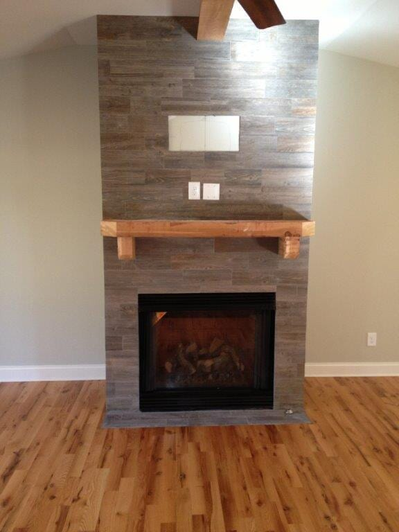 wood burning fireplace installation in Braselton GA from Purdy Flooring & Design