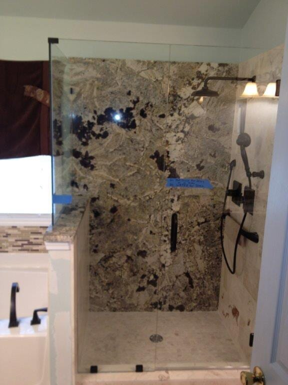 Glass shower door installation in Buford GA from Purdy Flooring & Design