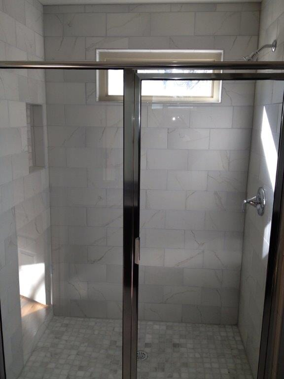 Glass shower door installation in Braselton GA from Purdy Flooring & Design