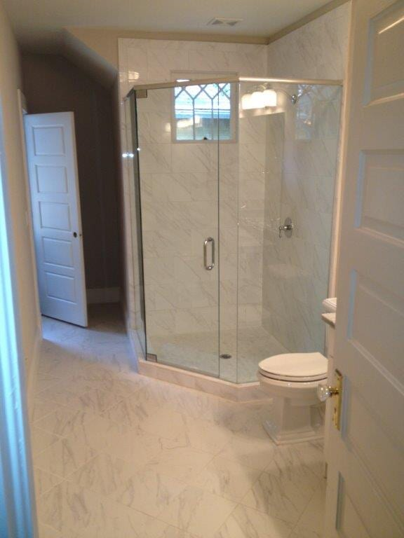 Custom glass shower door installation in Suwannee GA from Purdy Flooring & Design