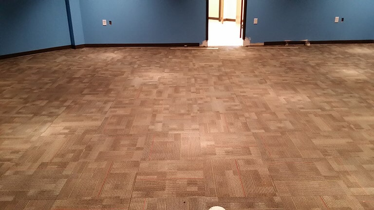 Commercial hardwood floor installation near Dacula GA by Purdy Flooring & Design