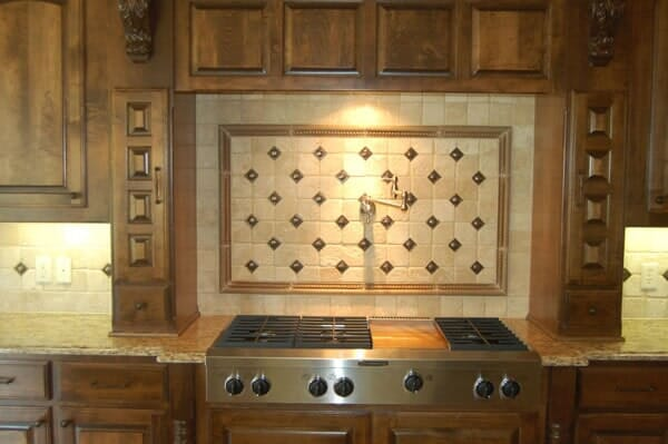Stove backsplash with pot filler in Fort Worth TX by Masters Flooring