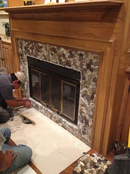 Custom fireplace mantles in Colleyville TX by Masters Flooring