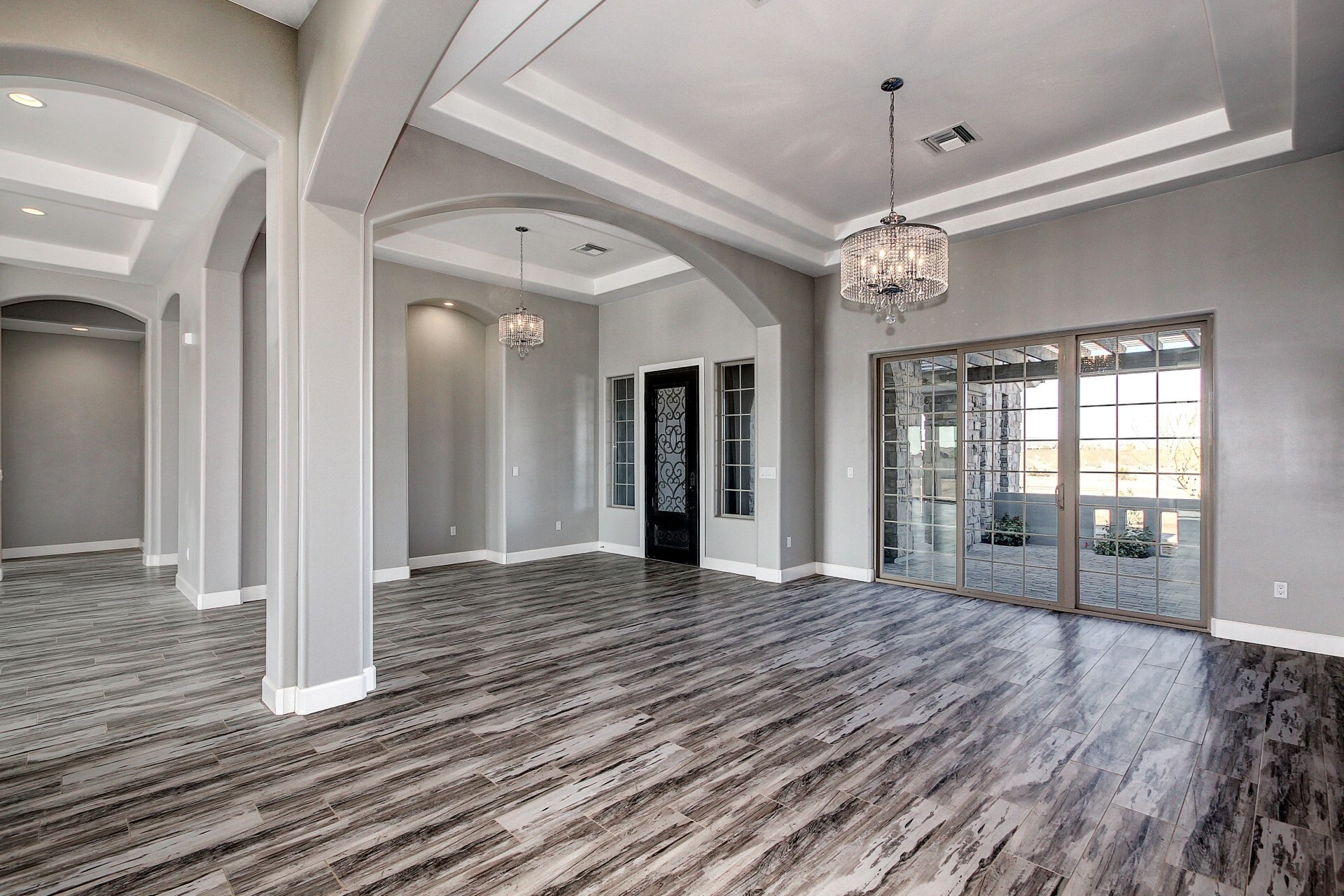 "Monterey Tile Vita Bella 8""x40"" Porcelain Plank Tile in Silver installed in Calle Lejos by Arrowhead Carpet & Tile"