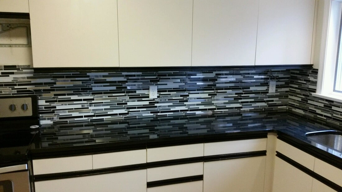 A new backsplash we installed in West Hartford, using Arctic Night mosaic by Bliss.