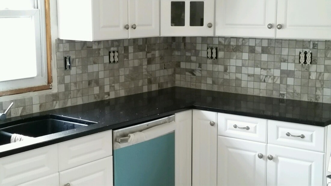 2x2 Crown Grey Mosaic installed in Windsor, CT as a backsplash. Part of a beautiful line we stock.