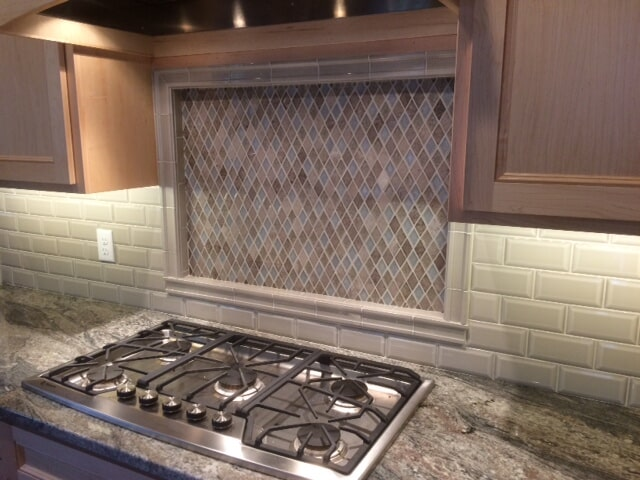 Jeffrey Court Enchanted Shadow 3X6 wall field tile with Collage Collection Rhomboid Mosaic installed in West Hartford, Connecticut. We can help you give your Kitchen a facelift with a new backsplash!