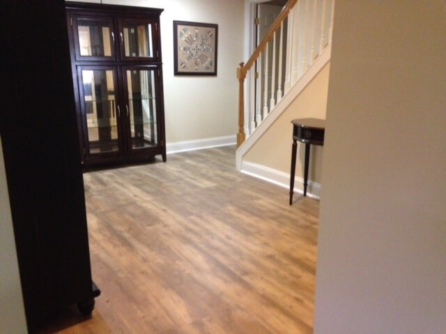 Luxury vinyl plank floor installed in East Hampton, CT using Armstrong's Farmhouse collection (color: natural look) was an easy installation with their new FastTak feature