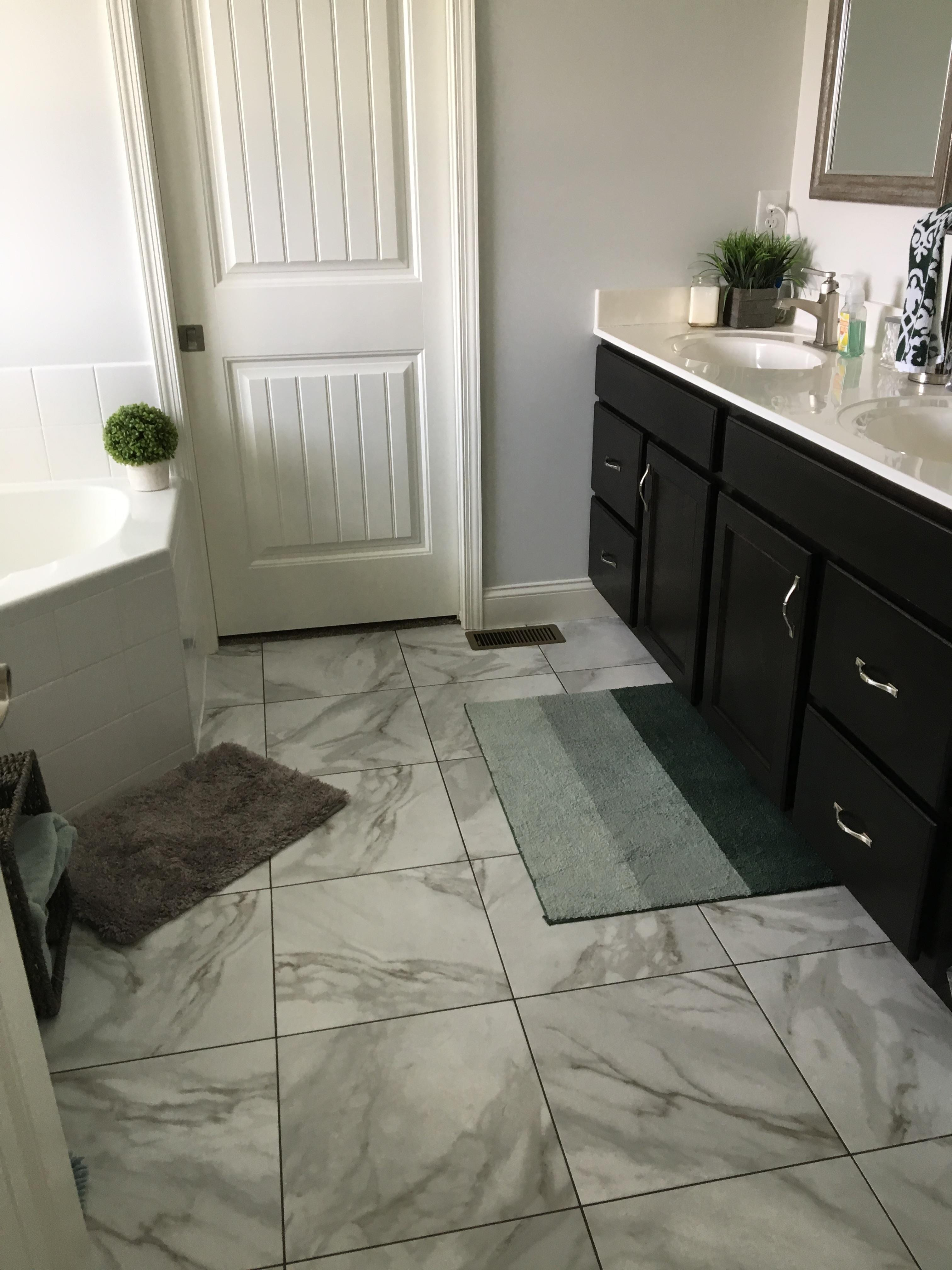 "Bathroom Floor: Luxury Vinyl Tile Armstorng Alterna Reserve Rossini Marble 16""x16"" color is Gray Mist with shale grout"
