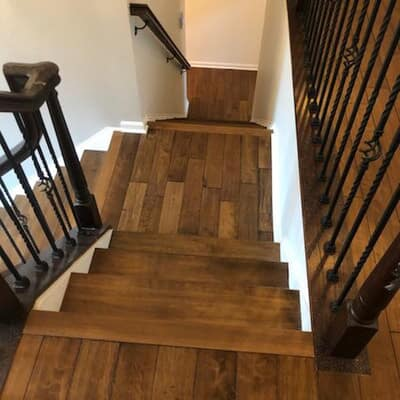 Custom stained steps to match pre-finished floor in Ellicott City from Mallary Carpet & Flooring