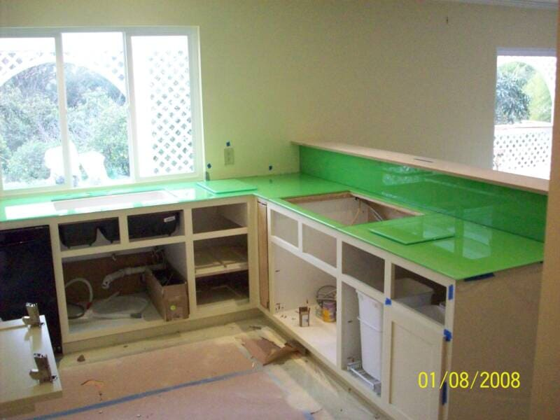 View of green top cabinets