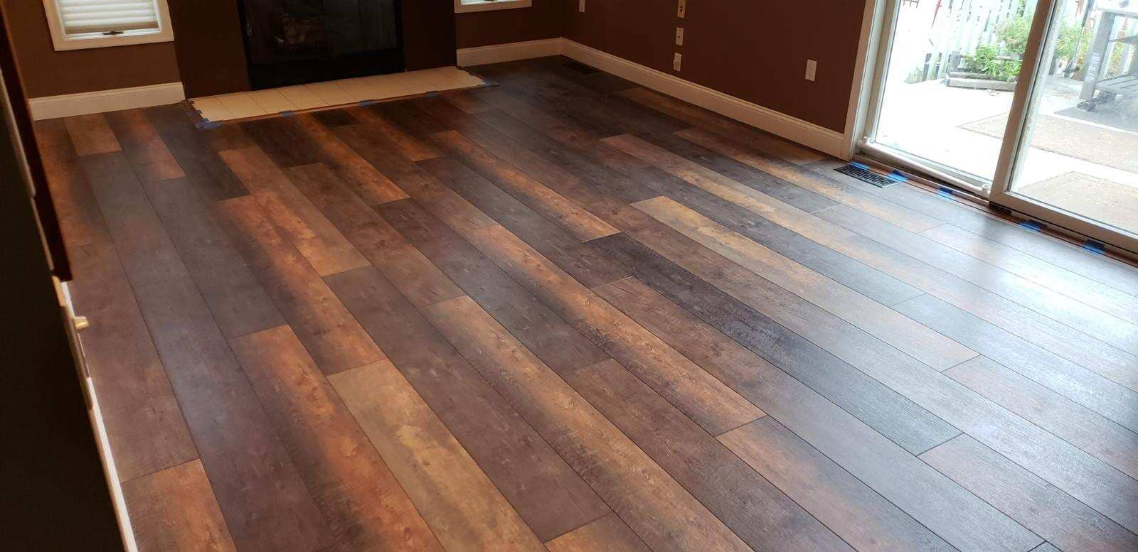 Shaw Floorte Luxury Vinyl Plank flooring in style Titan that we installed in this living room remodel in Howell, New Jersey