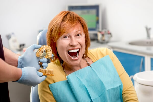 associates denture smiling red head