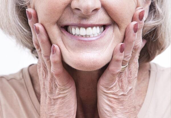 associates denture-smiling senior