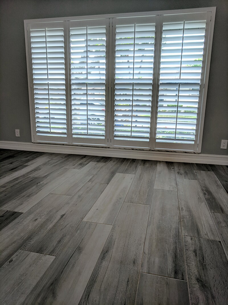 Plantation Shutters and the Wood Style Plank Tile installation from Capitol Carpet & Tile and Window Fashions in Boynton Beach, FL
