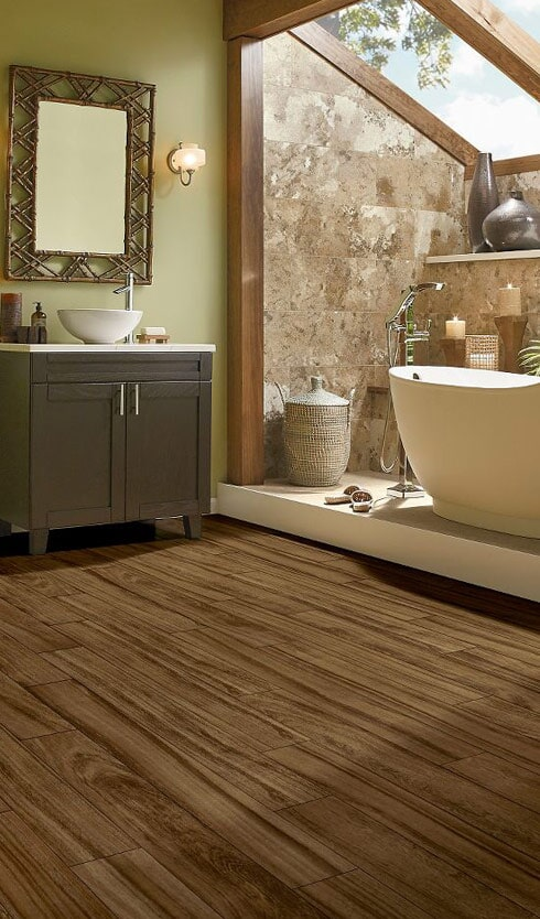 Wood look waterproof flooring for the bathroom in Huntington Beach, CA from Bixby Plaza Carpets & Flooring