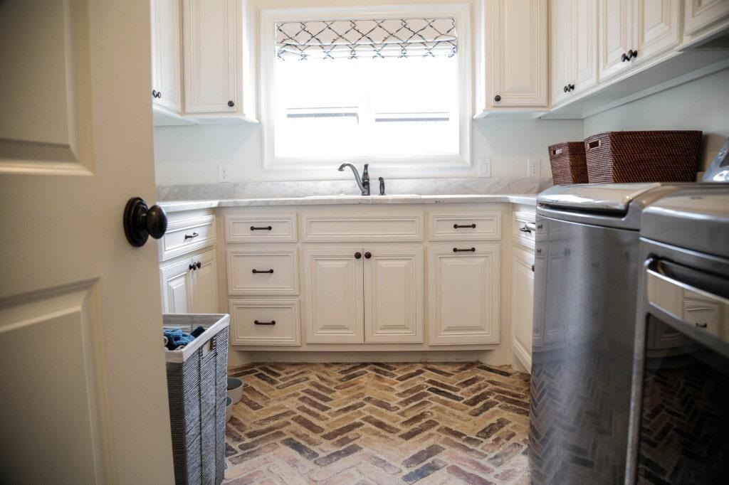 Unique herringbone tumbled tile flooring by Yates Flooring Center