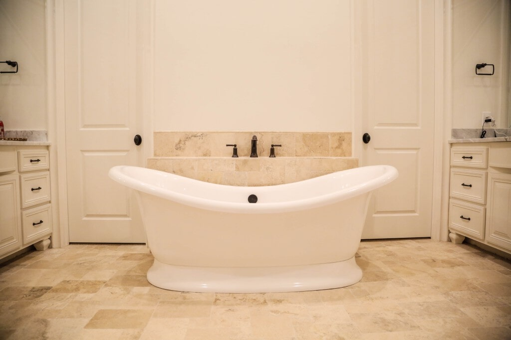 Bathroom remodel with custom tile flooring and tub surround by Yates Flooring Center