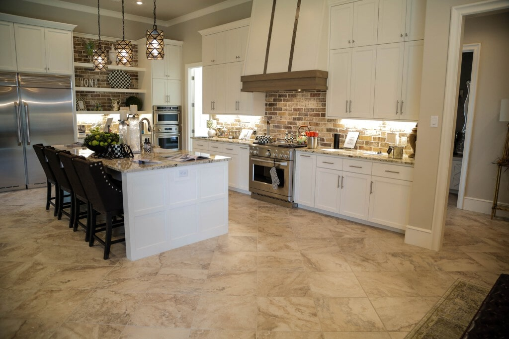 Full kitchen remodel with custom tile flooring by Yates Flooring Center