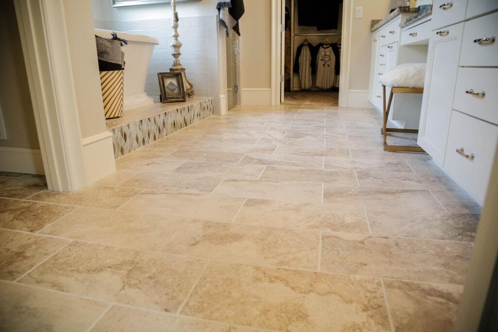 Bathroom tile floor installation by Yates Flooring Center