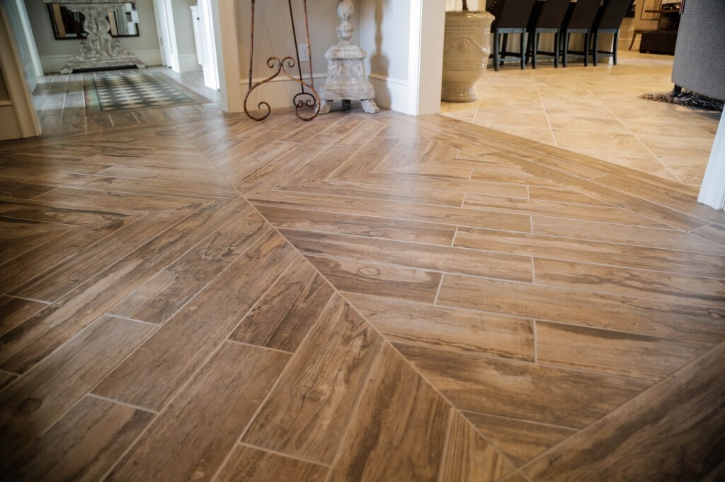 Wood look porcelain tile floor with unique pattern by Yates Flooring Center